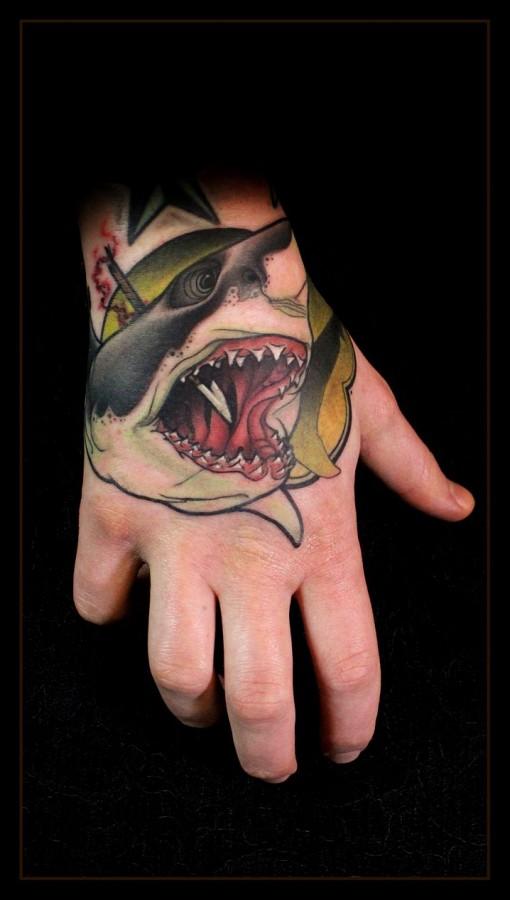 Stabbed shark hand tattoo