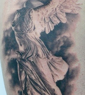 Statue tattoo by Xavier Garcia Boix