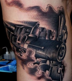 Steaming train side tattoo