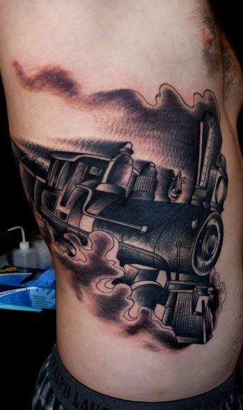 Steaming train side tattoo