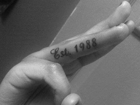 Stunning black finger's tattoo