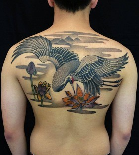 Stunning crane back tattoo