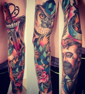 Stunning full arm tattoo by Alex Dorfler
