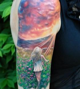 Stunning girl and sunset tattoo