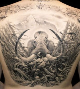 Stunning mammoth back tattoo by James Tattooart
