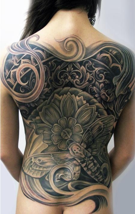 Stunning moth back tattoo
