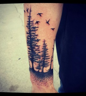 Stunning pine tree arm tattoo