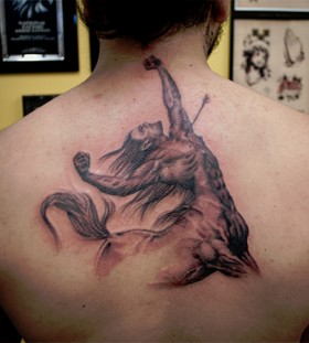 Stunning sagittarius back tattoo