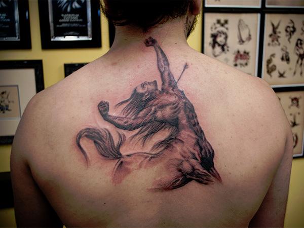 Stunning sagittarius back tattoo