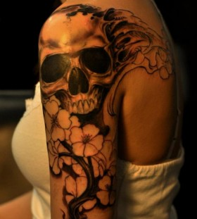 Stunning skull and flowers tattoo