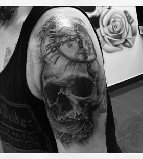 Stunning skull clock tattoo