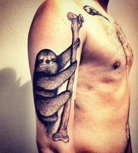 Stunning sloth arm tattoo