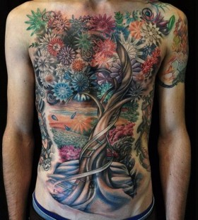 Stunning tree and flowers tattoo by David Allen
