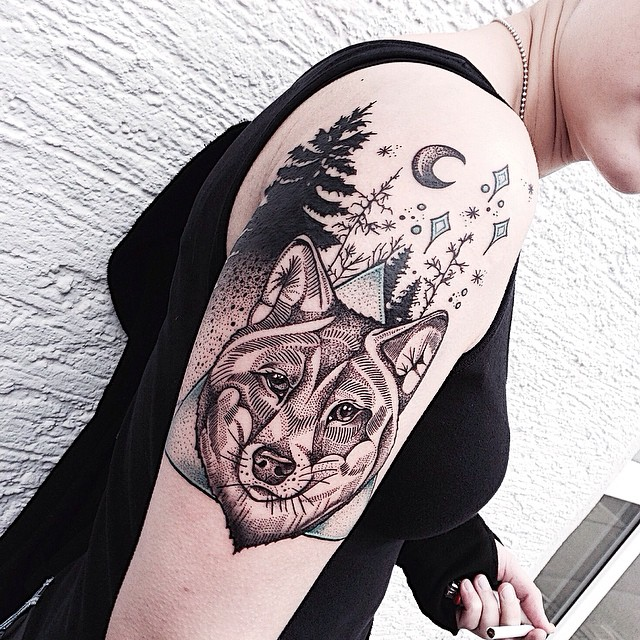 Stunning wolf arm tattoo