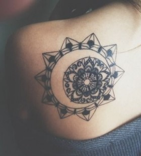 Sun and star mandala tattoo