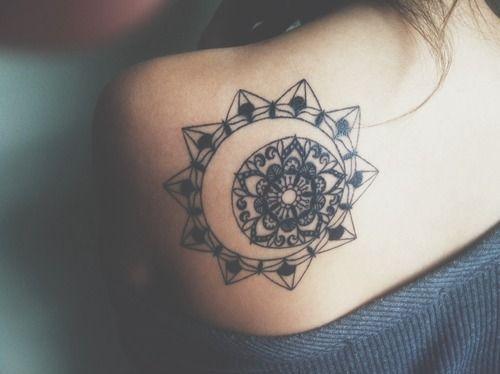 Sun and star mandala tattoo