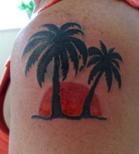 Sunset and palm tree tattoo