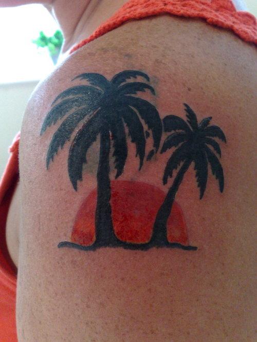 Sunset and palm tree tattoo
