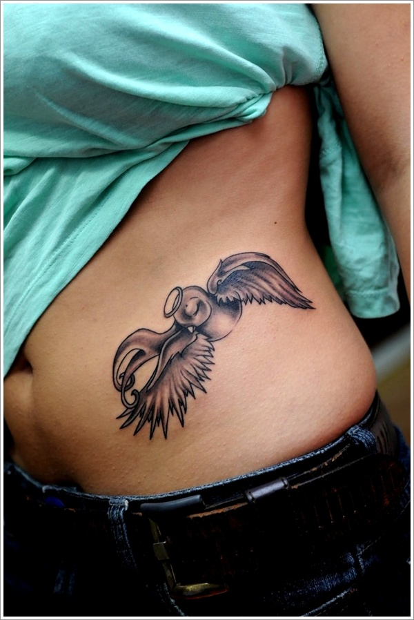 Swallow angel hip tattoo