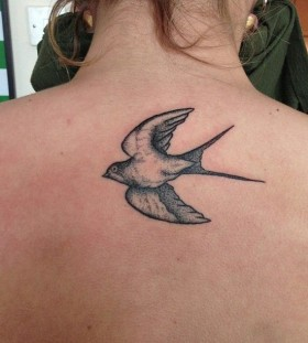 Swallow back tattoo by Rebecca Vincent