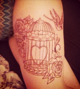Sweet birdcage leg tattoo