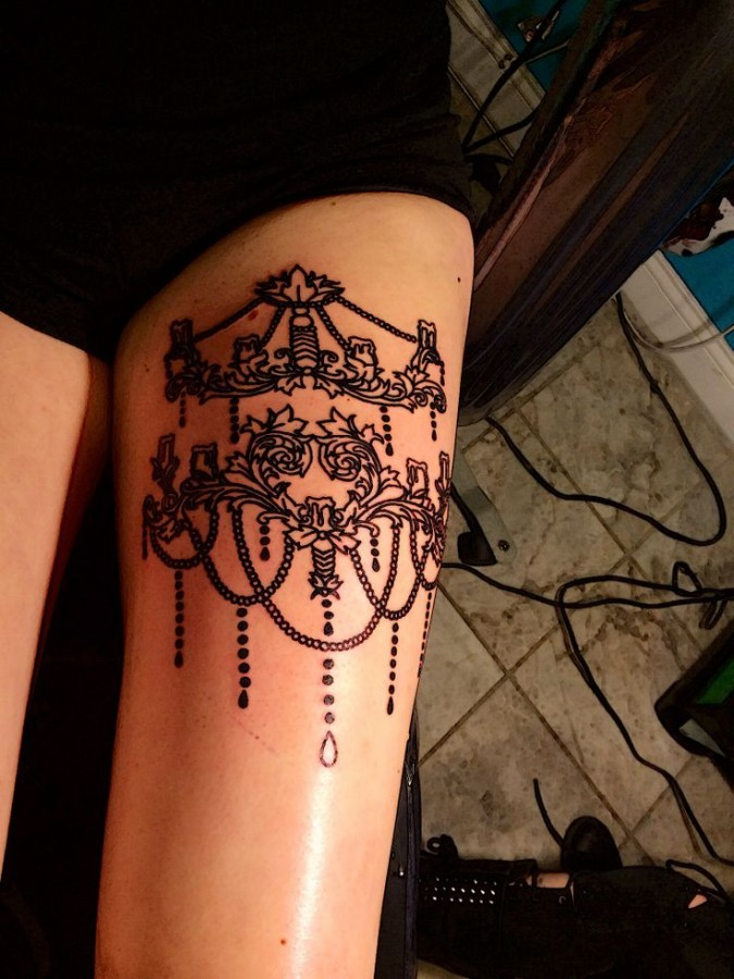 Sweet chandelier leg tattoo