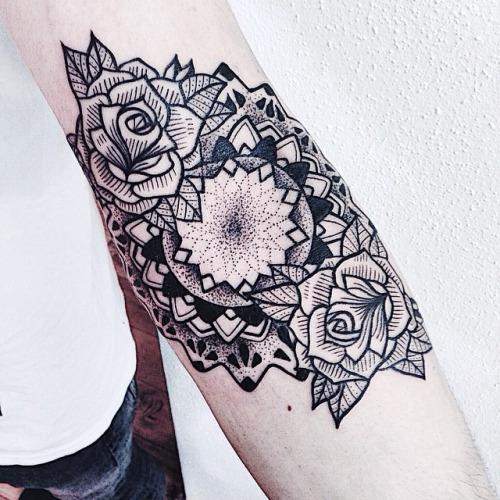 Sweet flowers arm tattoo