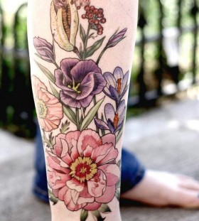 Sweet flowers leg tattoo by Alice Kendall