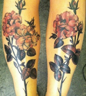 Sweet flowers leg tattoos by Amanda Leadman