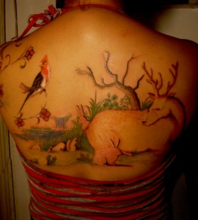 Sweet jungle back tattoo