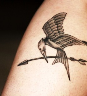Sweet mockingjay leg tattoo