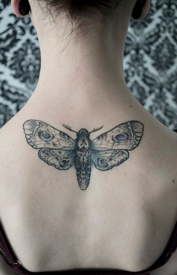 Sweet moth back tattoo