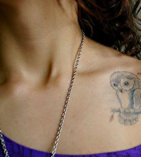 Sweet owl collarbone tattoo