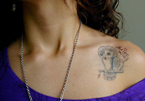 Sweet owl collarbone tattoo