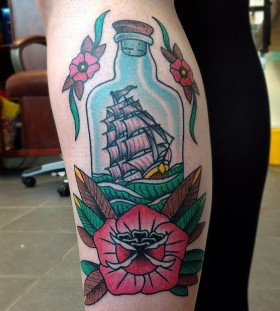 Sweet ship in a bottle tattoo