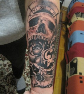 Sweet skull clock arm tattoo