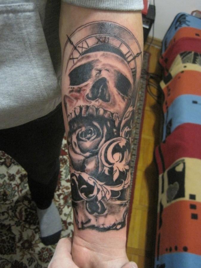 Sweet skull clock arm tattoo