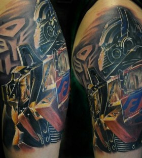 Sweet transformers arm tattoo