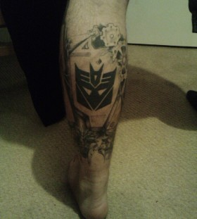 Sweet transformers logo leg tattoo