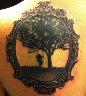 Swing on a tree frame tattoo