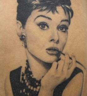 Tattoo of Audrey Hepburn by Xavier Garcia Boix