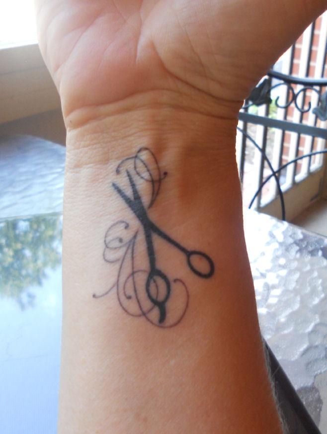 Gorgeous looking scissor tattoo