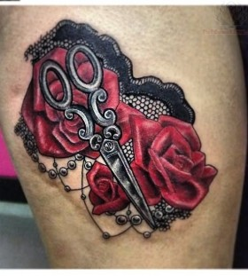 Red roses and scissor tattoo