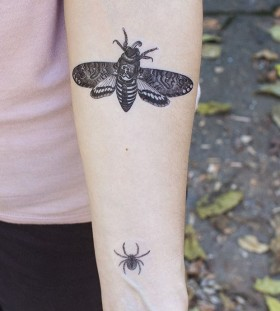 Adorable black bee tattoo on arm