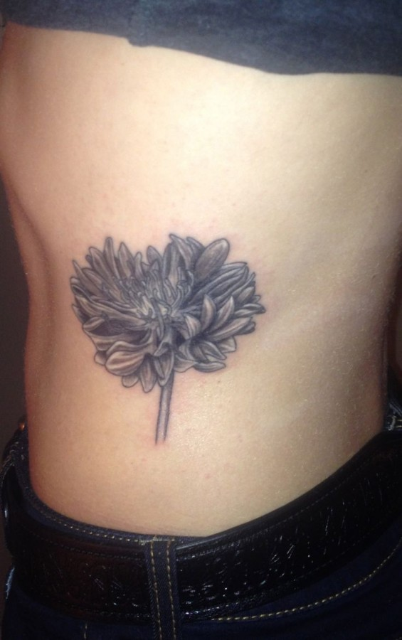 Adorable black cornflower tattoo