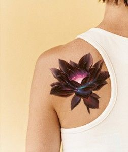 Adorable black flower tattoo