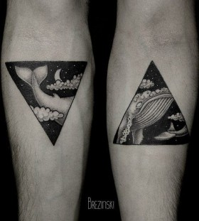 Adorable black triangle style whale tattoo