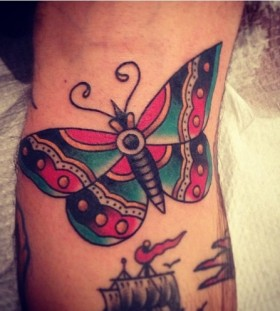 Adorable butterfly American Traditional Tattoo