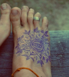 Adorable eyes and flower foot tattoo