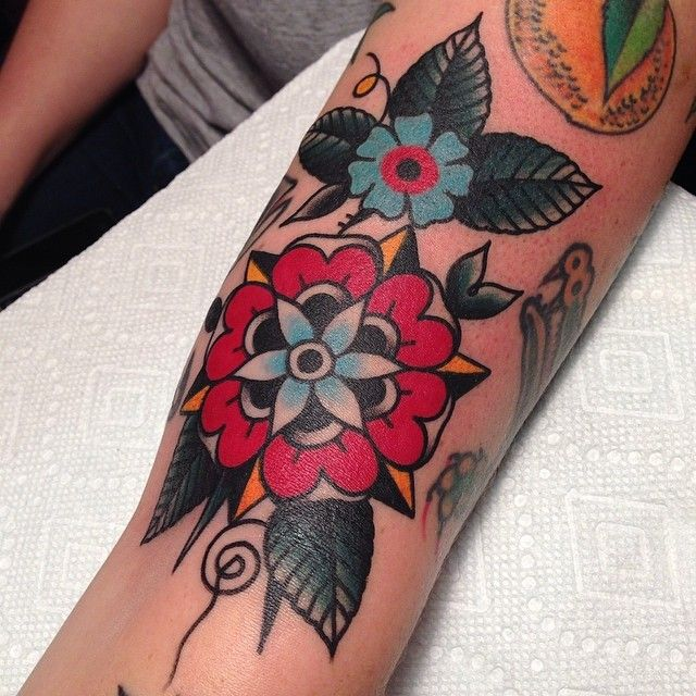 Adorable flowers tattoo by Austin Maples